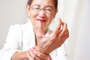 woman with hand arthritis