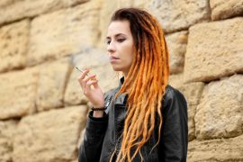 Young beautiful woman with weed